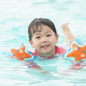 A little girl swimming in a pool