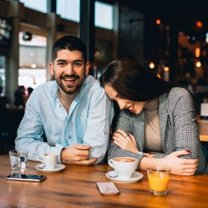 A young couple at a local restaurant enjoying a drink